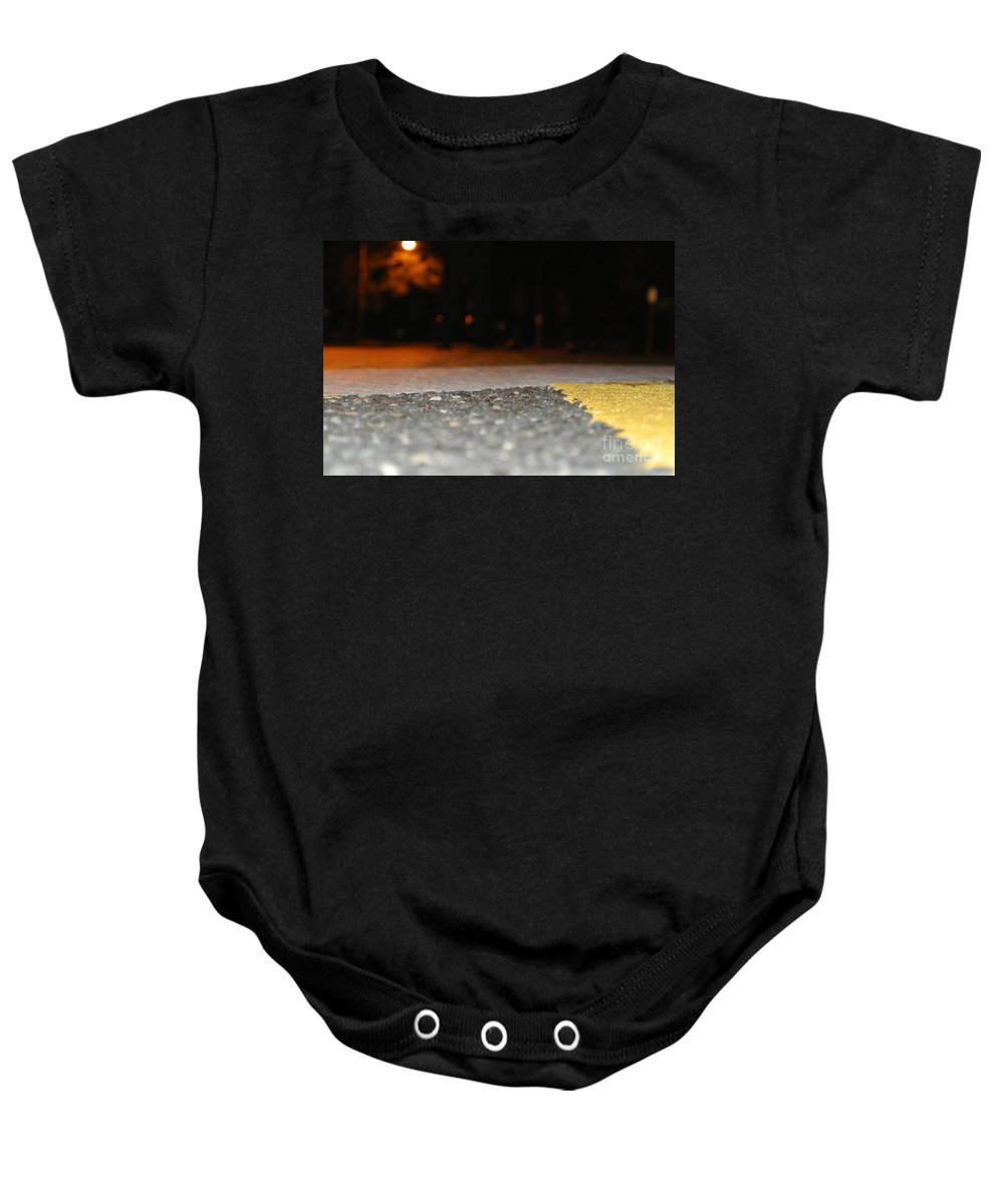 Urban Baby Onesie featuring the photograph On The Ground by Charlotte Stevenson