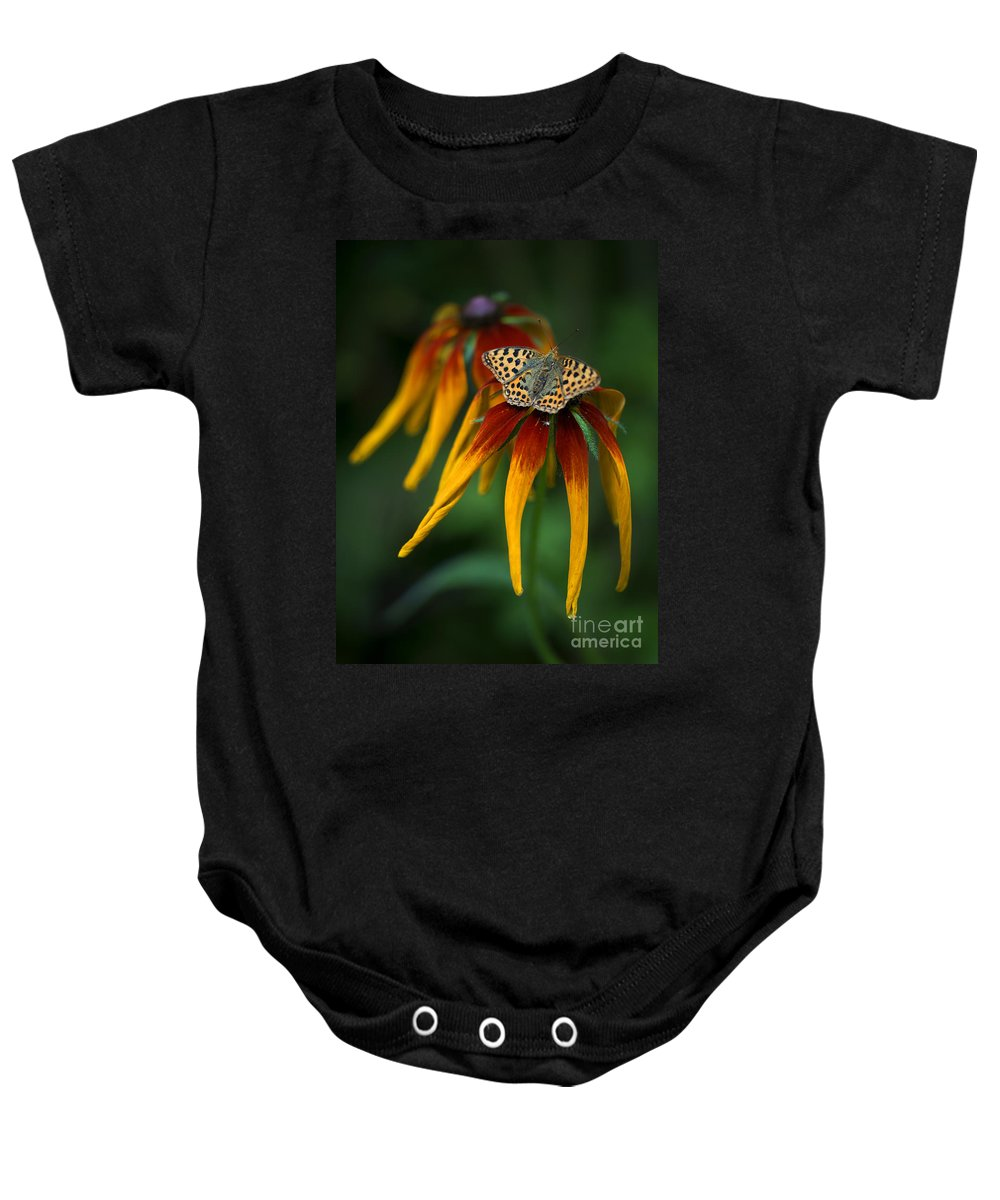 Macro Baby Onesie featuring the photograph Orange Butterfly With Black Dots Sitting Onthe Red And Yellow Long Petaled Flowers by Jaroslaw Blaminsky