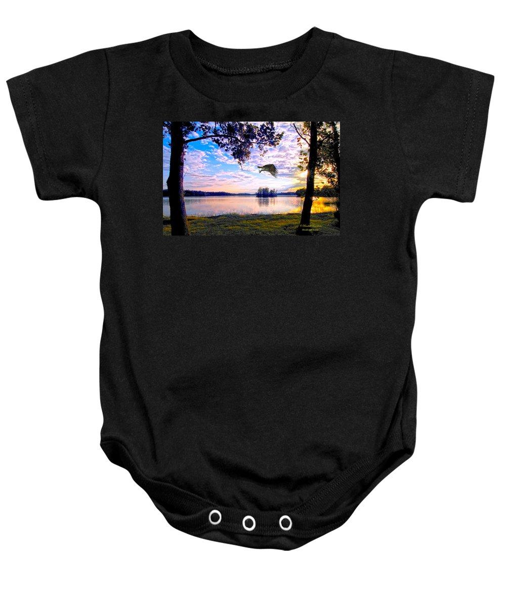Osprey Baby Onesie featuring the photograph Osprey Leaving Perch Sundown Lake by Randall Branham