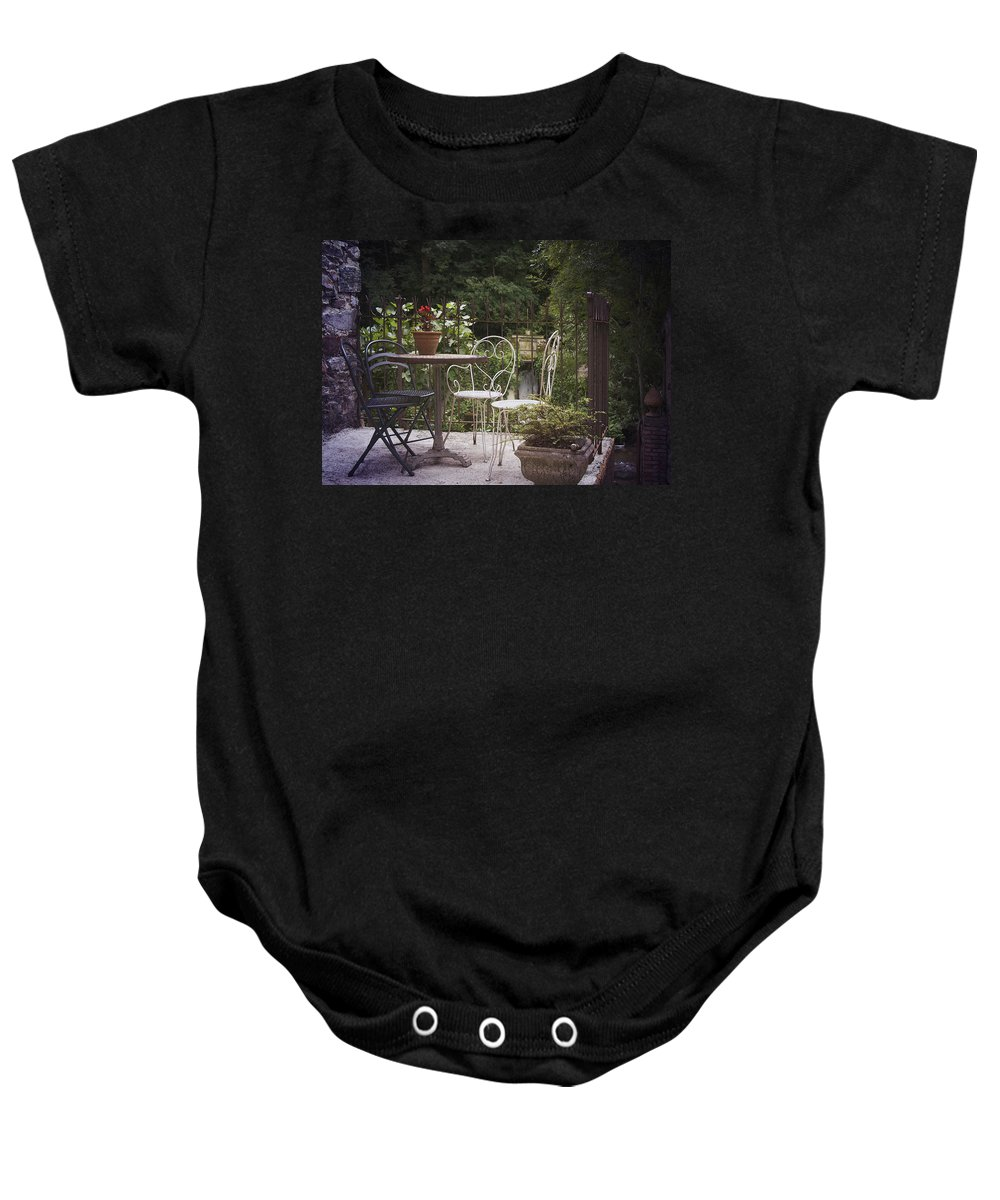 France Baby Onesie featuring the photograph Patio Les Cascades Durfort France by Greg Kluempers