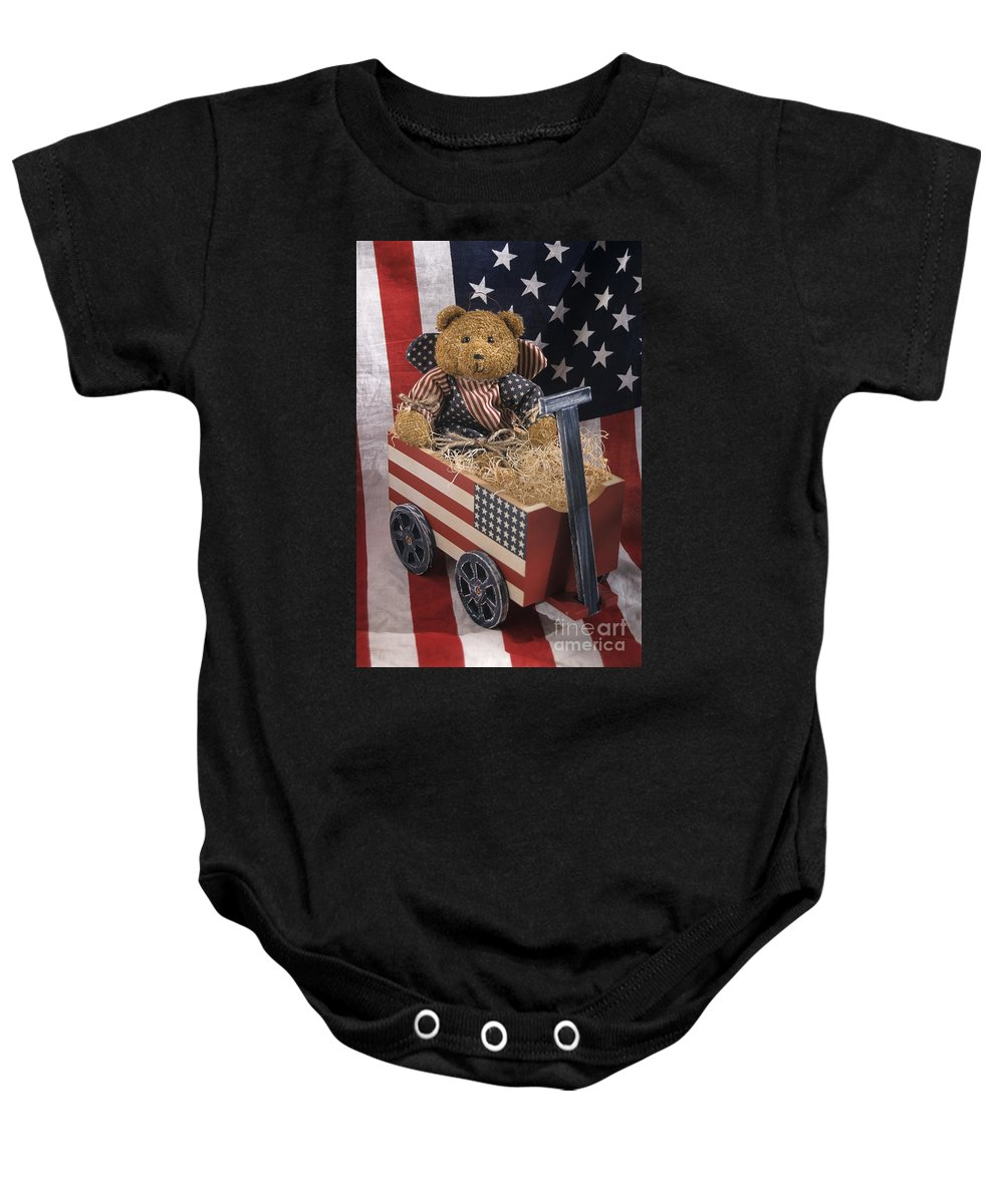 United States Baby Onesie featuring the photograph Patriot Bear by Sharon Elliott