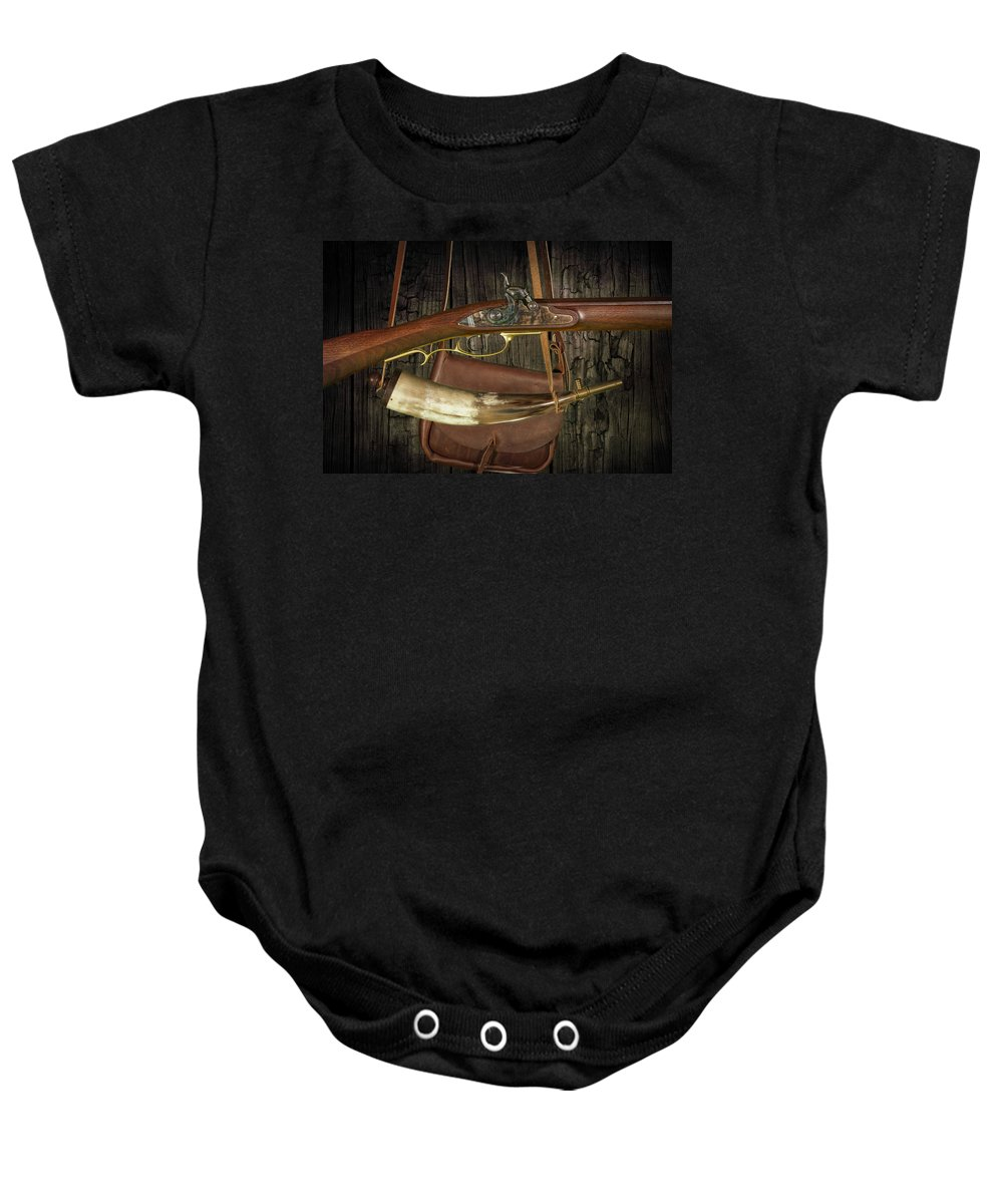 Art Baby Onesie featuring the photograph Percussion Cap And Ball Rifle With Powder Horn And Possibles Bag by Randall Nyhof