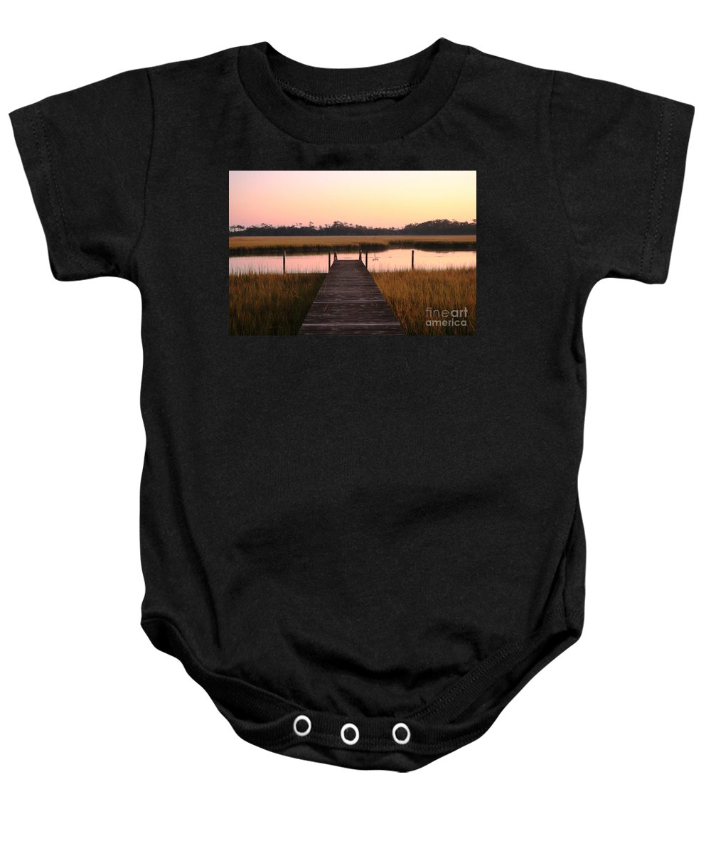 Pink Baby Onesie featuring the photograph Pink And Orange Morning On The Marsh by Nadine Rippelmeyer