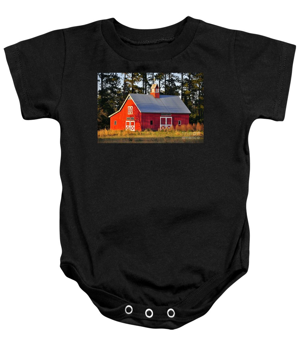 Barn Baby Onesie featuring the photograph Radiant Red Barn by Al Powell Photography USA