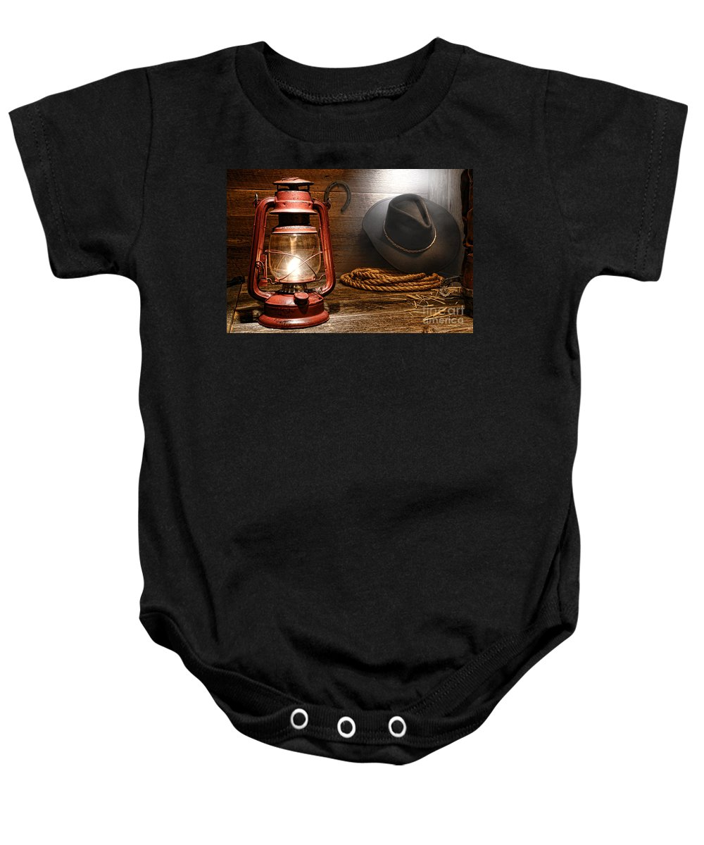 Western Baby Onesie featuring the photograph Ranch Light by Olivier Le Queinec