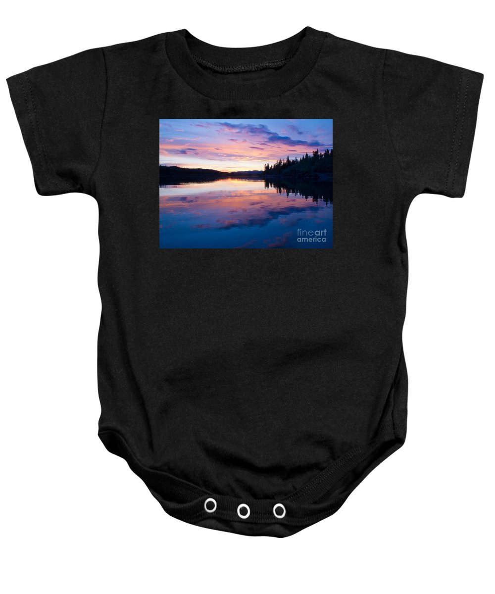 Airy Baby Onesie featuring the photograph Reflection Of Sunset Sky On Calm Surface Of Pond by Stephan Pietzko