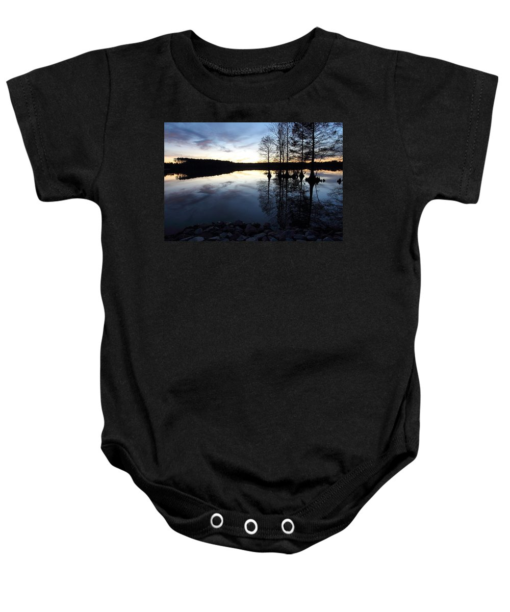 Lake Baby Onesie featuring the photograph Reflections On Lake At Sunset by April Copeland