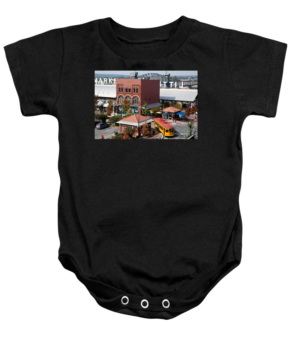 Skyline Scenes Baby Onesie featuring the photograph River Market In Little Rock Arizona by Bill Cobb