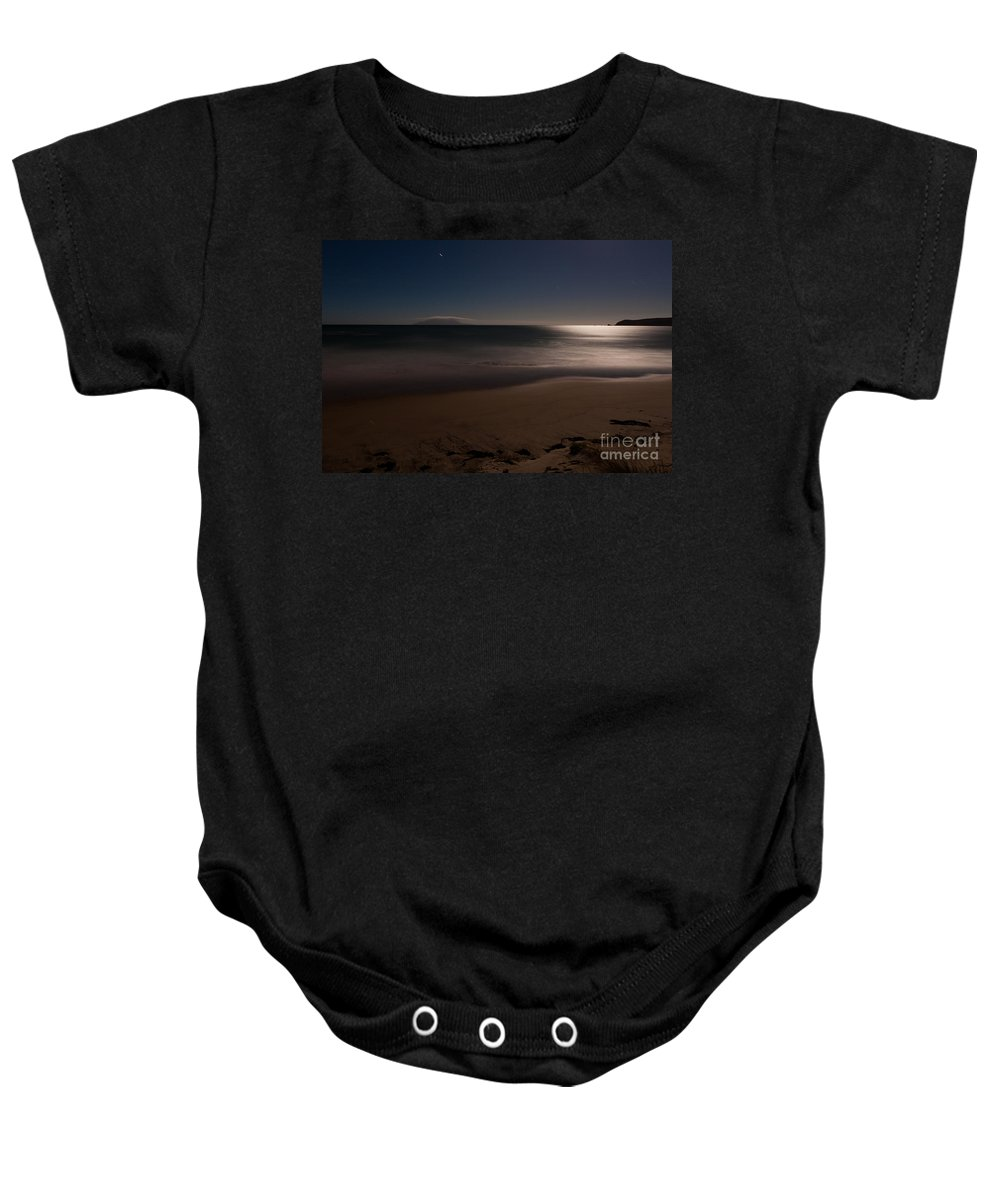 Background Baby Onesie featuring the photograph Romantic Moonlight Ocean Sand Beach Long Exposure by Stephan Pietzko