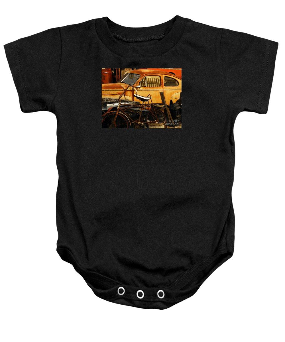 Junkyard Baby Onesie featuring the photograph Rust Race by Joe Jake Pratt