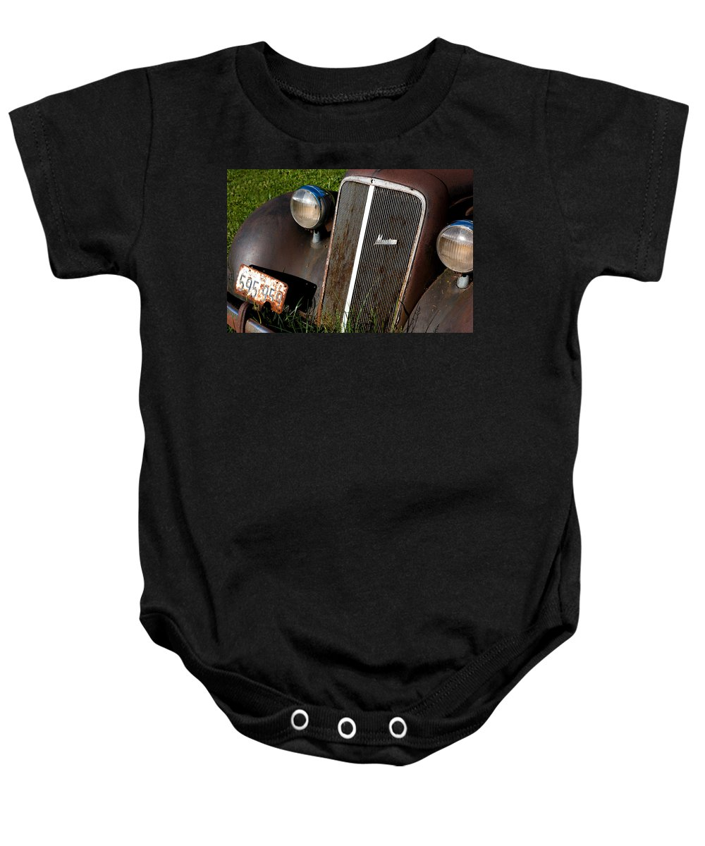 Car Baby Onesie featuring the photograph Rusted Master by Cale Best