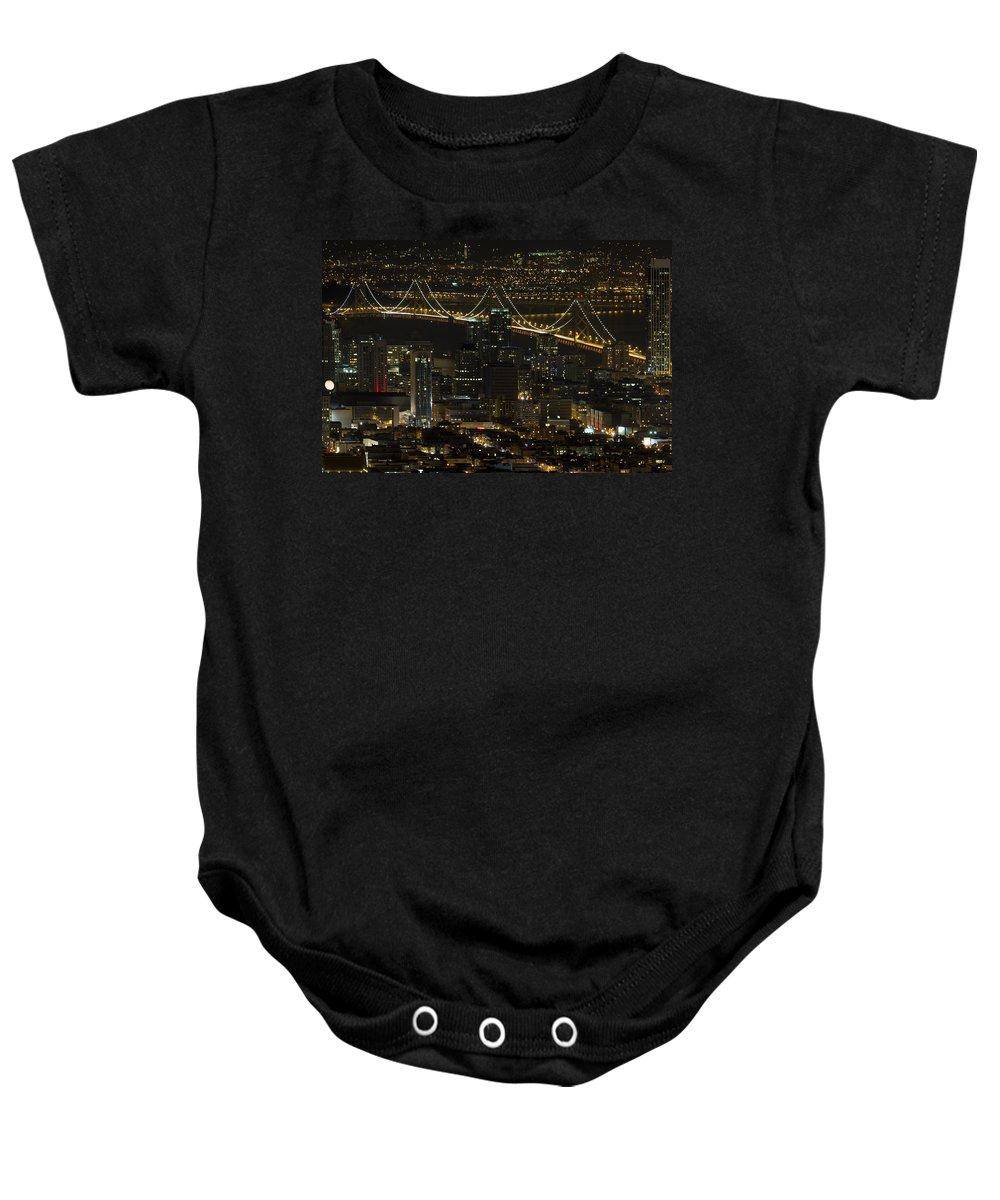 San Baby Onesie featuring the photograph San Francisco Cityscape With Oakland Bay Bridge At Night by David Gn