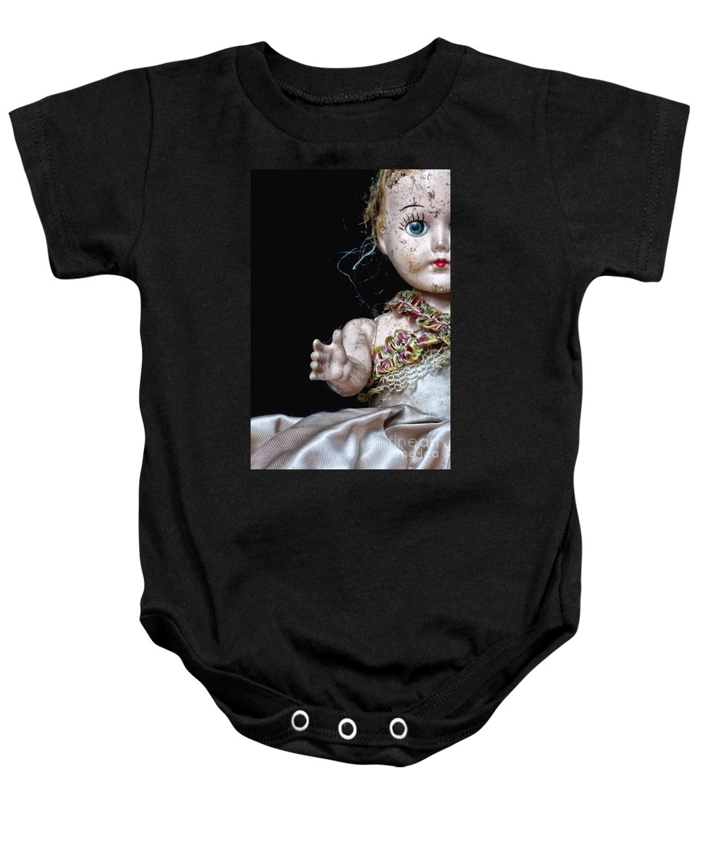 Antique; Broken; Childhood; Cracked; Dirty; Doll; Eerie; Eyes; Face; Gazing; Heirloom; Nostalgia; Old; Retro; Ruined; Scary; Staring; Toy; Vintage; Weird; Worn; Dark; Creepy; Female; Dress; Porcelain; Girl; Arm; Hair; Matted; Black; Caucasian; Vintage Baby Onesie featuring the photograph Seeking Attention by Margie Hurwich