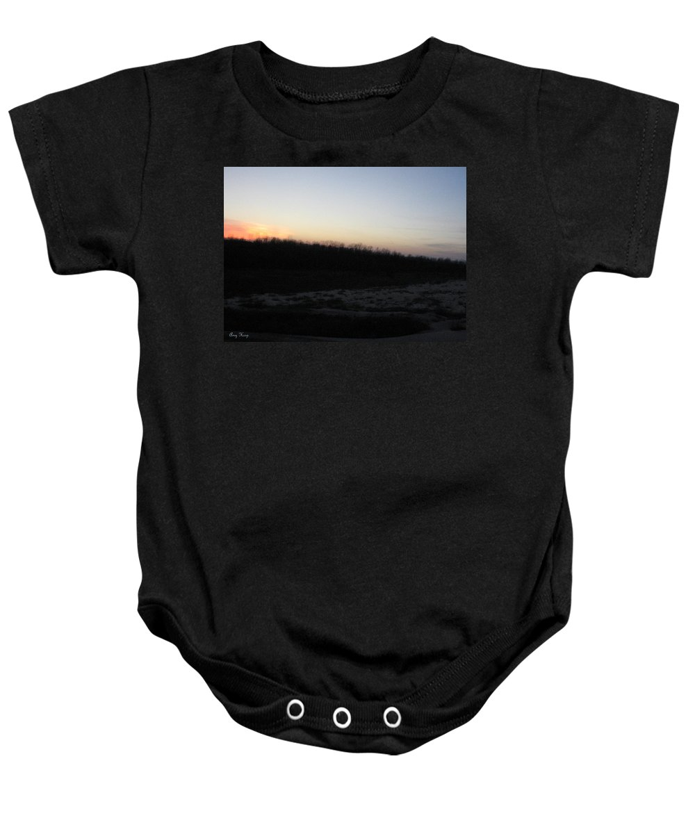 Sunset Baby Onesie featuring the photograph Setting Sun On The Dried Up Red River by Amy Hosp