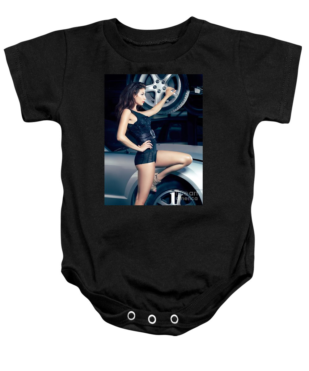 Fashion Baby Onesie featuring the photograph Sexy Mechanic Girl Posing With Cars by Oleksiy Maksymenko