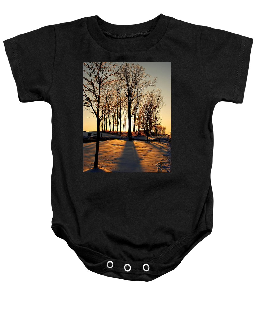 Silhouette Baby Onesie featuring the photograph Silhouette Of Trees And Ice by Frozen in Time Fine Art Photography