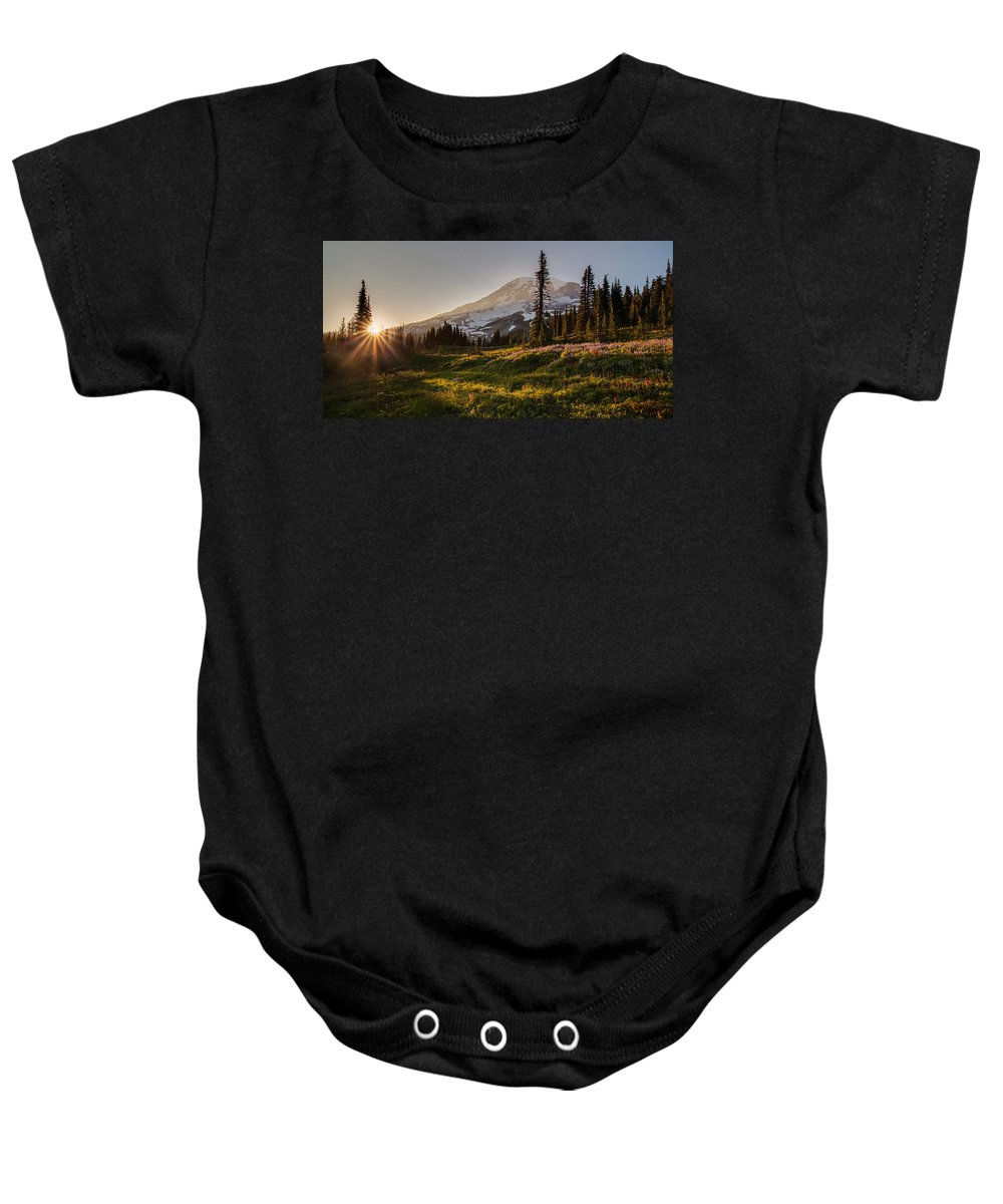 Rainier Baby Onesie featuring the photograph Skyline Meadows Sunstar by Mike Reid