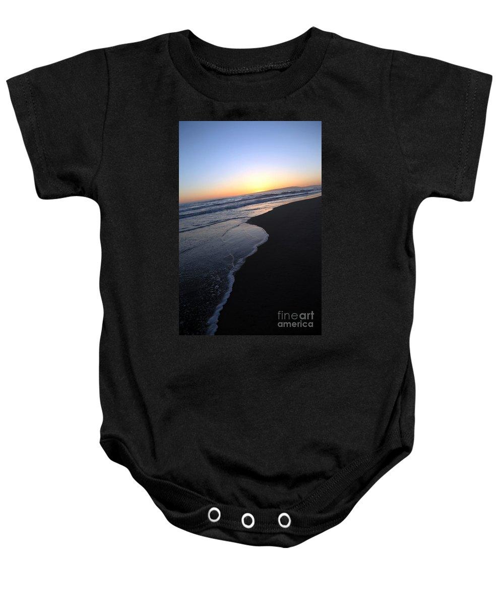 sunset Beach Baby Onesie featuring the photograph Sliding Down - Sunset Beach California by Amanda Barcon