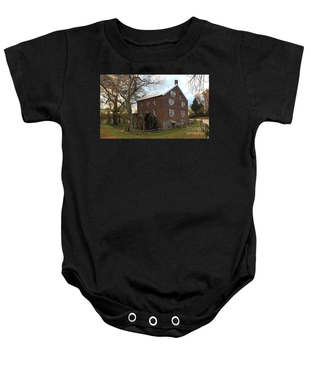 Kerr Mill Baby Onesie featuring the photograph Sloan Park Grist Mill by Adam Jewell