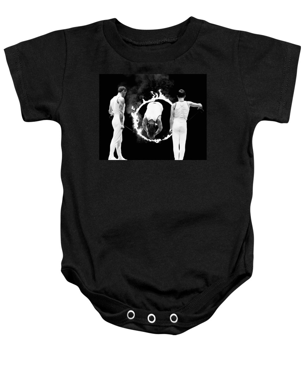 1035-773 Baby Onesie featuring the photograph Somersault Through Flames by Underwood Archives