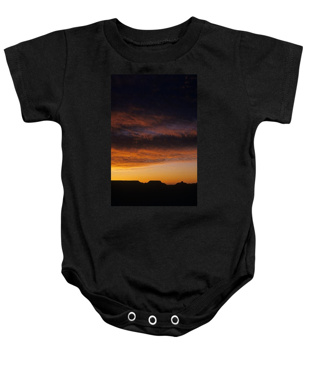 Grand Canyon National Park Baby Onesie featuring the photograph South Rim Grand Canyon Dramatic Clouds Sunset With Silhouetted R by Jim Corwin