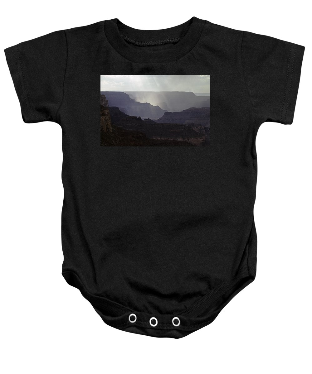 Grand Canyon National Park Baby Onesie featuring the photograph South Rim Grand Canyon Storm Clouds And Sunray Light On Rock For by Jim Corwin