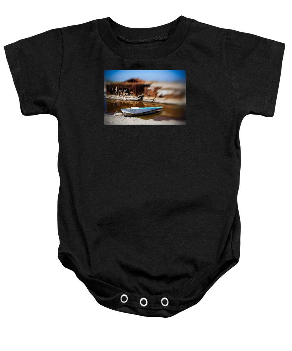 Salton Sea Baby Onesie featuring the photograph Speeding Away Boat Hull by Scott Campbell
