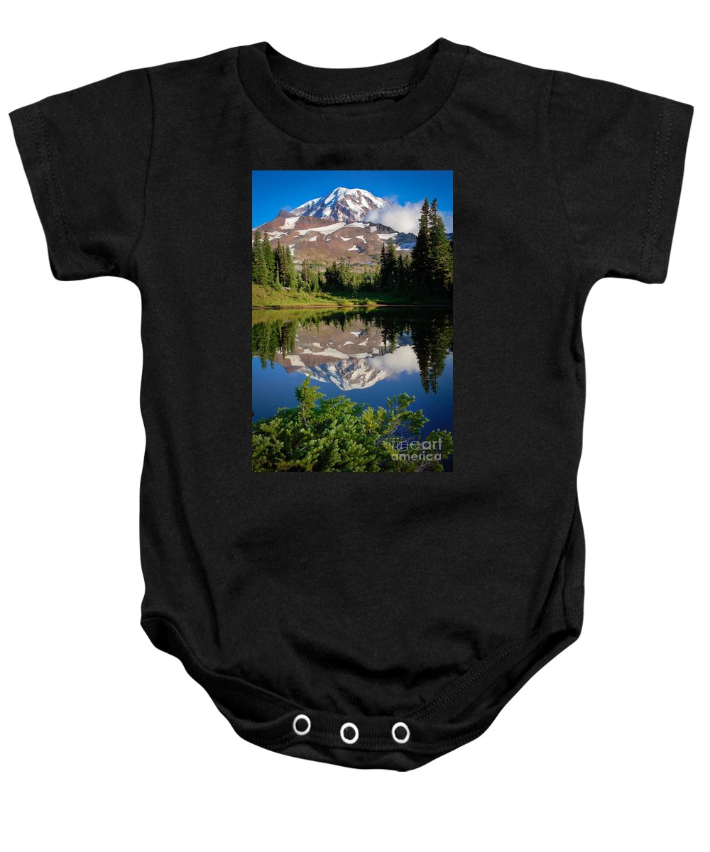 America Baby Onesie featuring the photograph Spray Park Reflection by Inge Johnsson