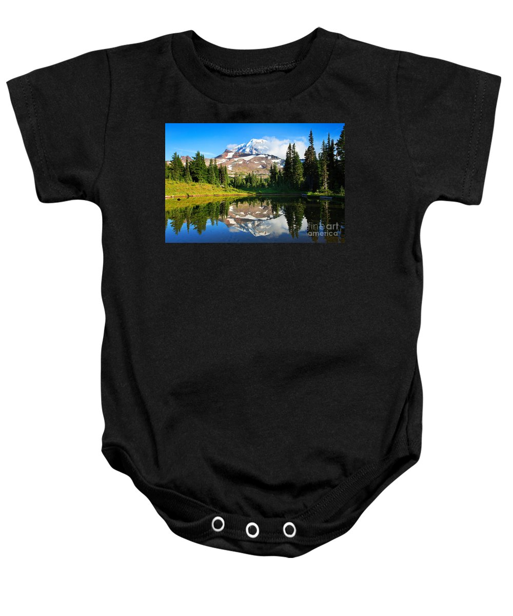 America Baby Onesie featuring the photograph Spray Park Tarn by Inge Johnsson