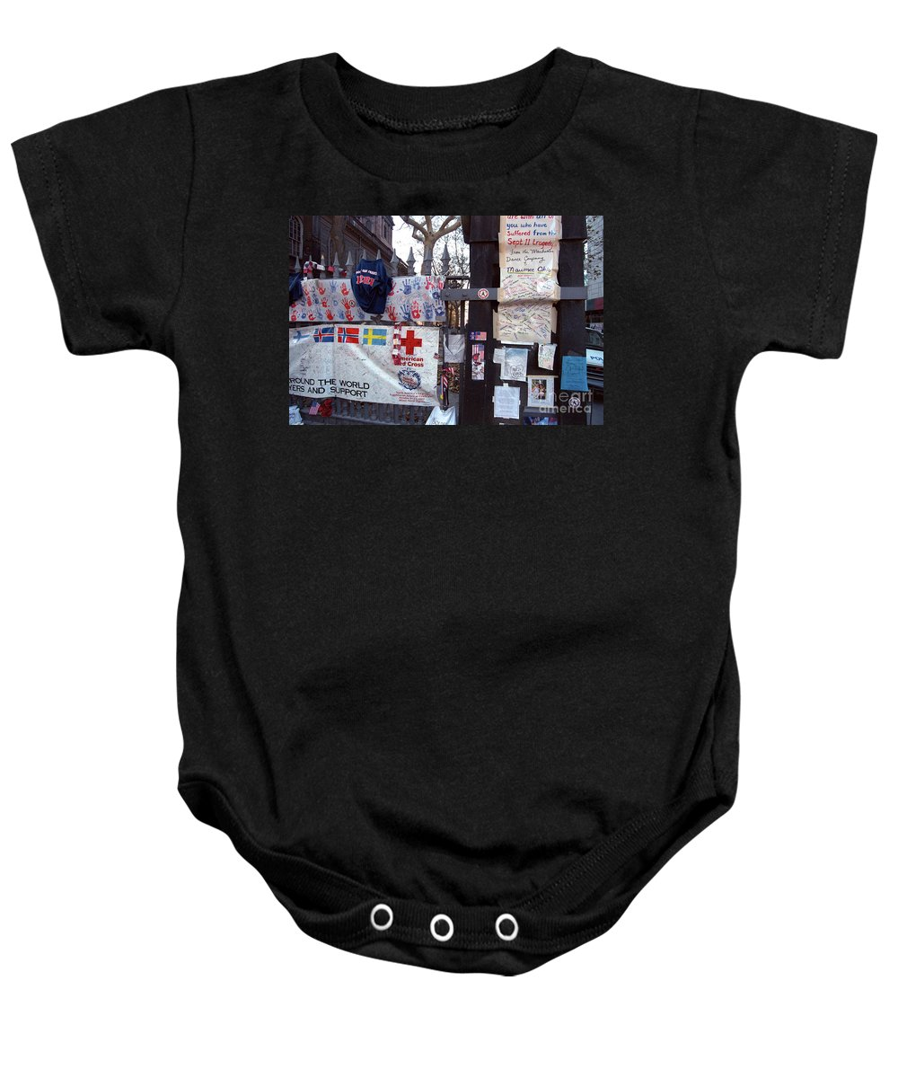 9-11 9/11 Sept. 11 2001 September Saint Paul's Chapel Finnish Flag Swedish American Tribute Memorial Fence Wrought Iron Fence Previously Unpublished Police Car Aftermath Nyfd Nypd Baby Onesie featuring the photograph St. Paul's Chapel Memorial 9-11 by Steven Dunn