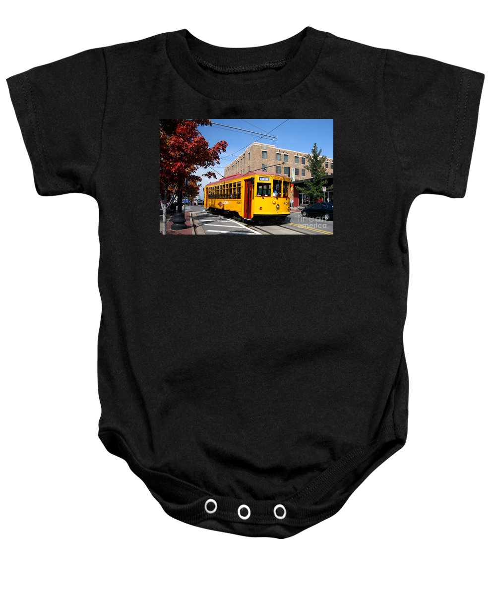 Skyline Scenes Baby Onesie featuring the photograph Street Car In Little Rock by Bill Cobb