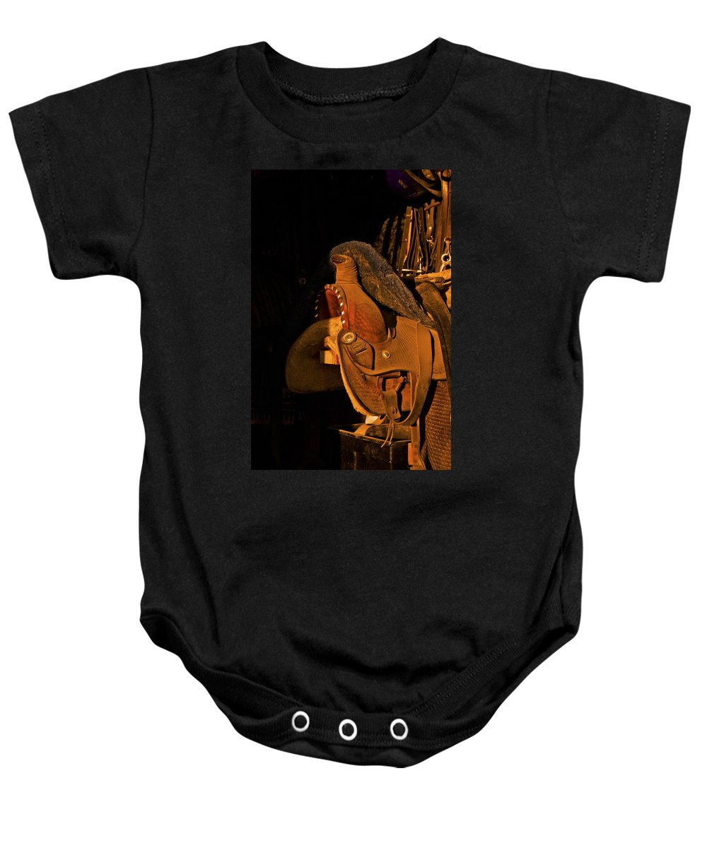 Horse Saddle Baby Onesie featuring the photograph Sun On Leather Horse Saddle In Tack Room Equestrian Fine Art Photography Print by Jerry Cowart