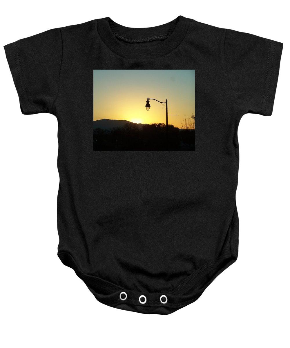 Sunset Baby Onesie featuring the photograph Sunset Street Light by Jennifer Allen