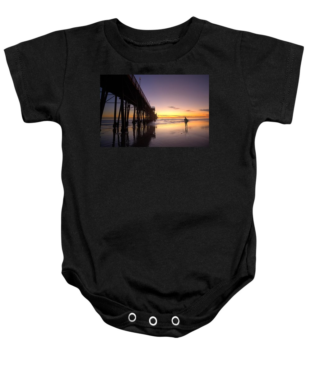 Surf Baby Onesie featuring the photograph Surfer At Sunset by Peter Tellone