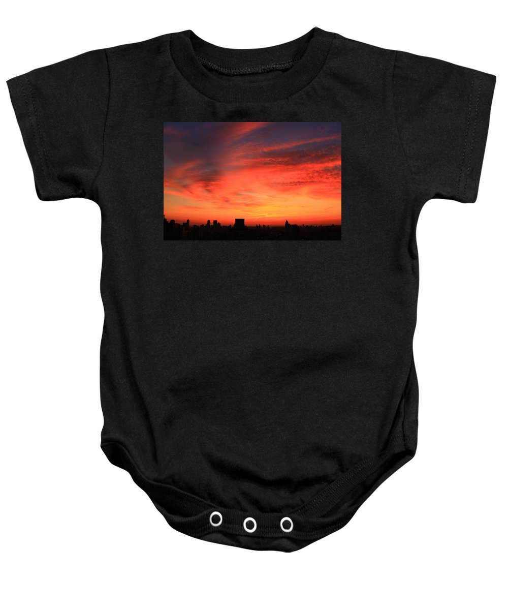 New York City Baby Onesie featuring the photograph Swirling Clouds by Catie Canetti
