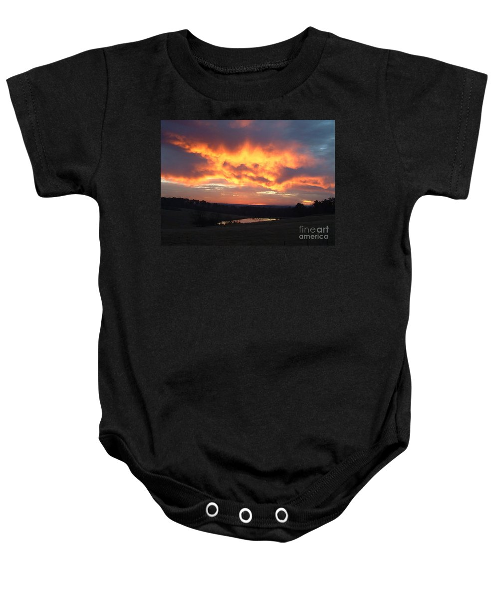 Reid Callaway Sun Baby Onesie featuring the photograph The Sunrise Face In The Clouds by Reid Callaway