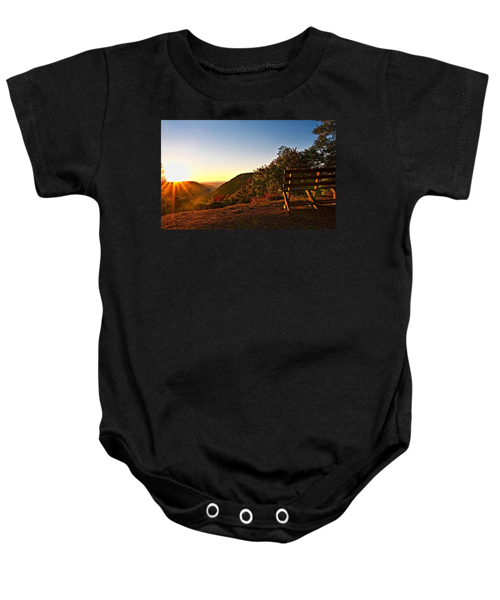 Babcock State Park Baby Onesie featuring the photograph The Magic Bench by Steve Harrington