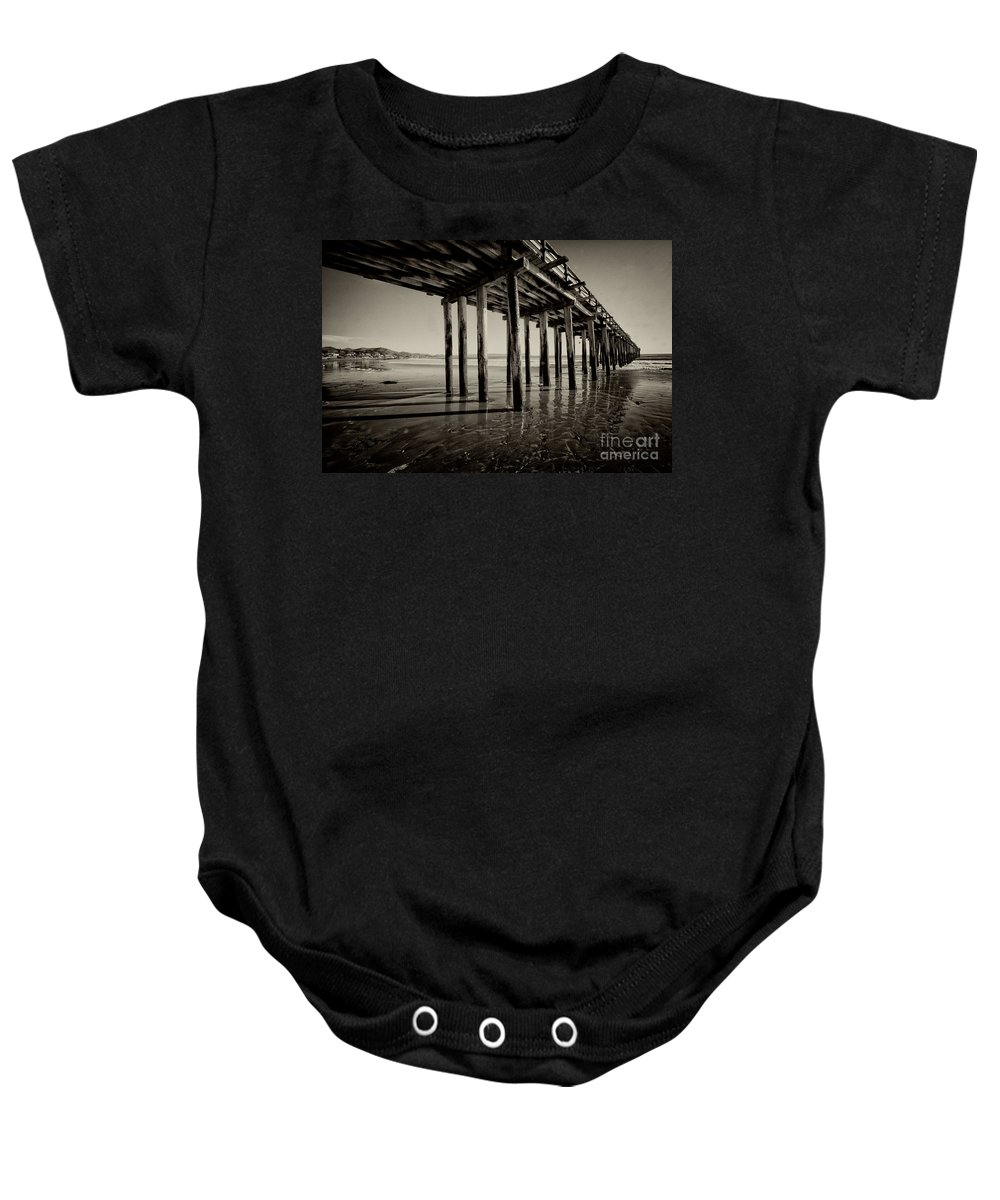 Cayucos California Pier Wood Wooden Beach Pacific Ocean Mono Black And White Sea Seaside Resort Surfing Baby Onesie featuring the photograph The Pier At Cayucos by Rob Hawkins