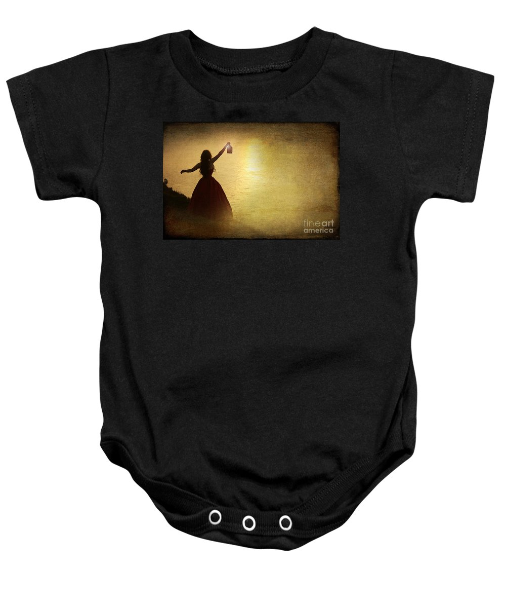 Woman Baby Onesie featuring the photograph The Lady With The Lamp by Jacqueline Moore