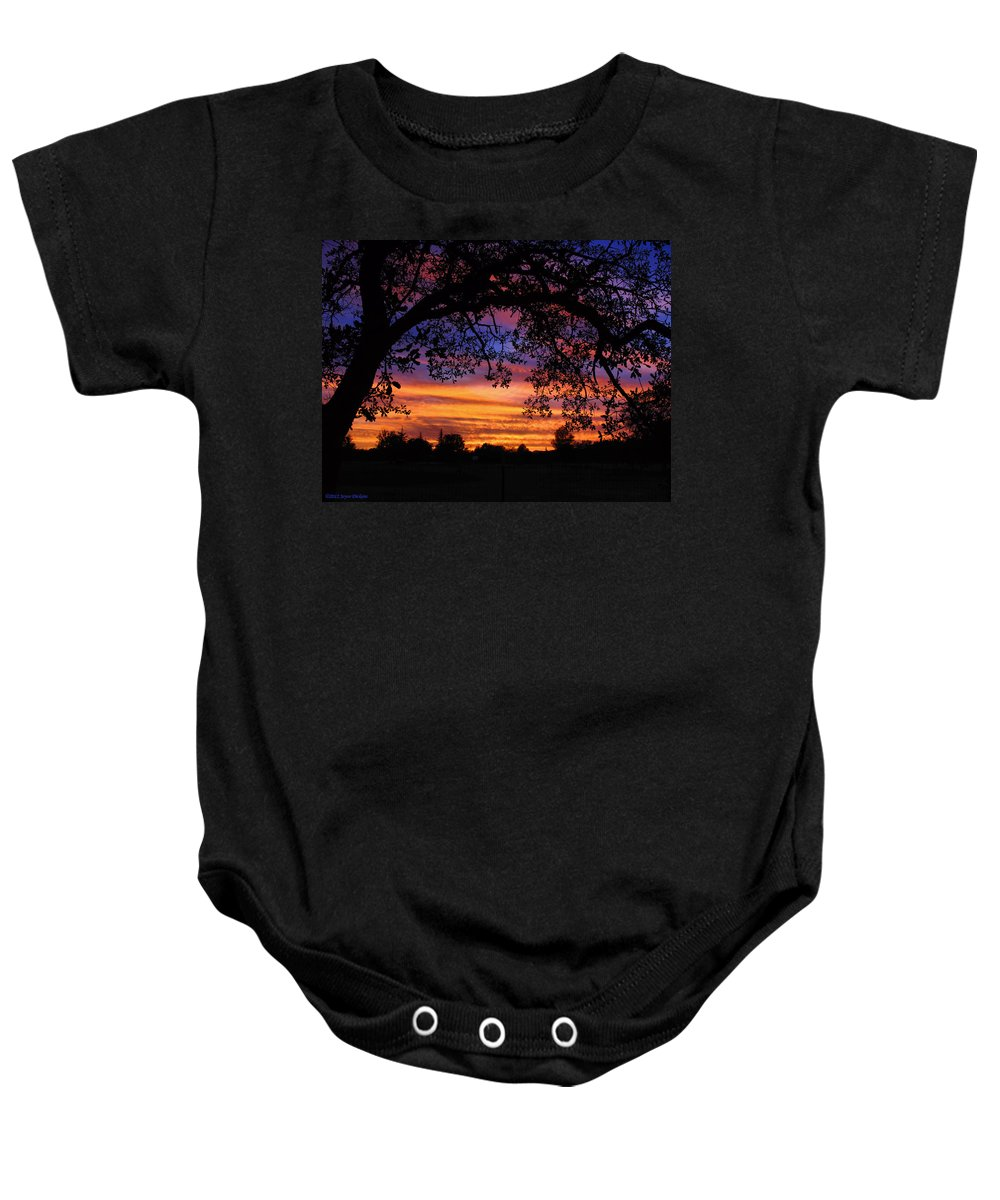 Sunset Baby Onesie featuring the photograph The Sun Sets For Mike by Joyce Dickens