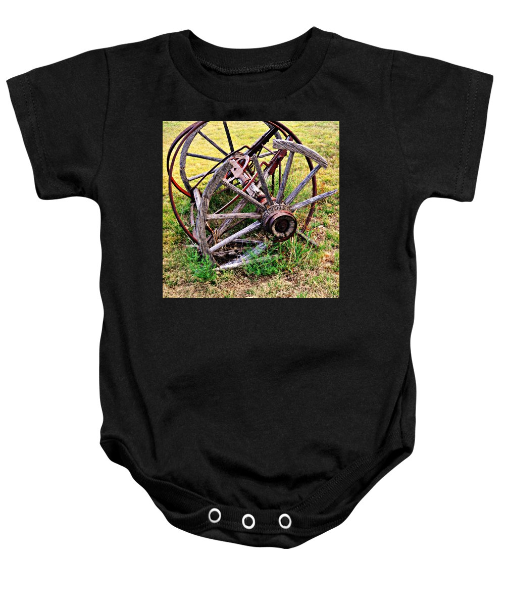 An Old Piece Of Farm Equipment Is Slowly Returning To Nature In The Ozarks Of Missouri. Baby Onesie featuring the photograph Thrasher Past by Marty Koch
