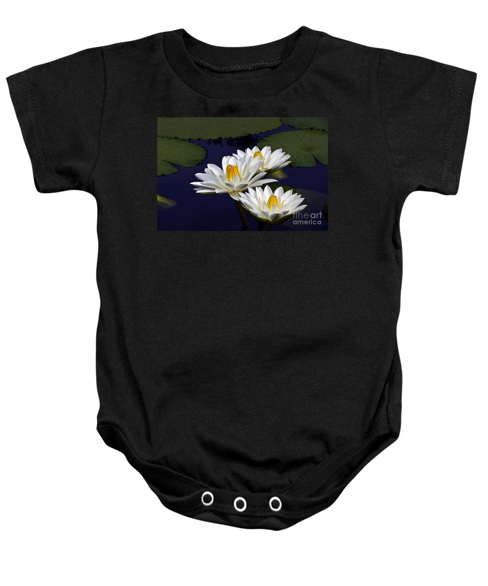 Nymphaea Baby Onesie featuring the photograph Three White Tropical Water Lilies Version 2 by Byron Varvarigos