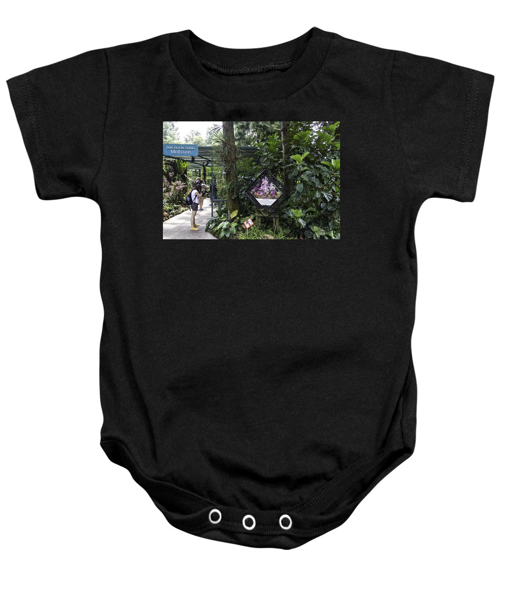 Asia Baby Onesie featuring the photograph Tourist Doing Photography And Viewing Plants In A Garden by Ashish Agarwal