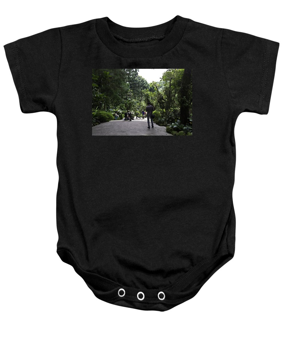 Asia Baby Onesie featuring the photograph Tourists Inside A Downward Sloping Section In The Orchid Garden by Ashish Agarwal
