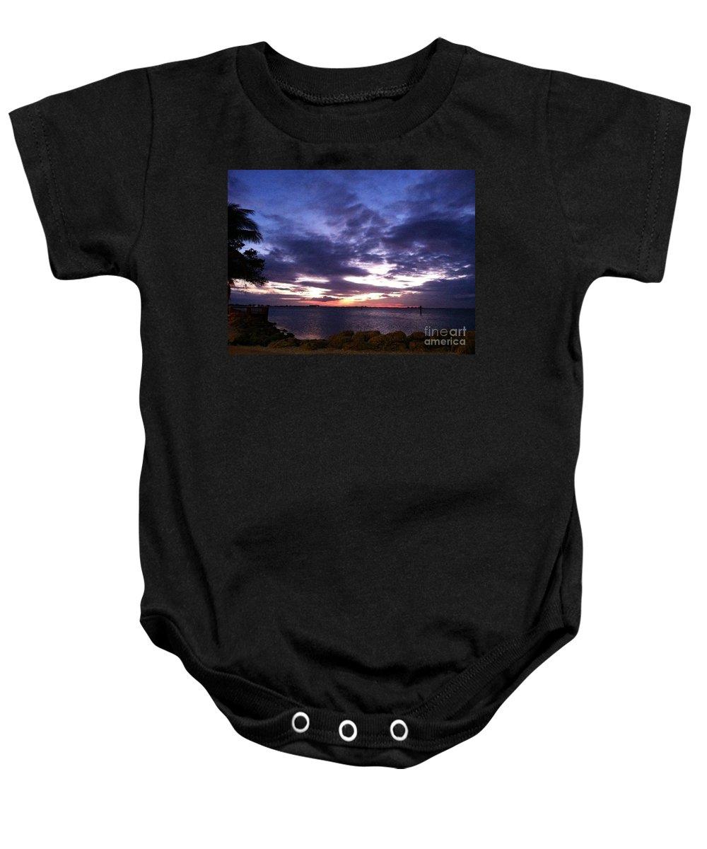 Sand Baby Onesie featuring the photograph True Blue Sunset by Melissa Darnell Glowacki