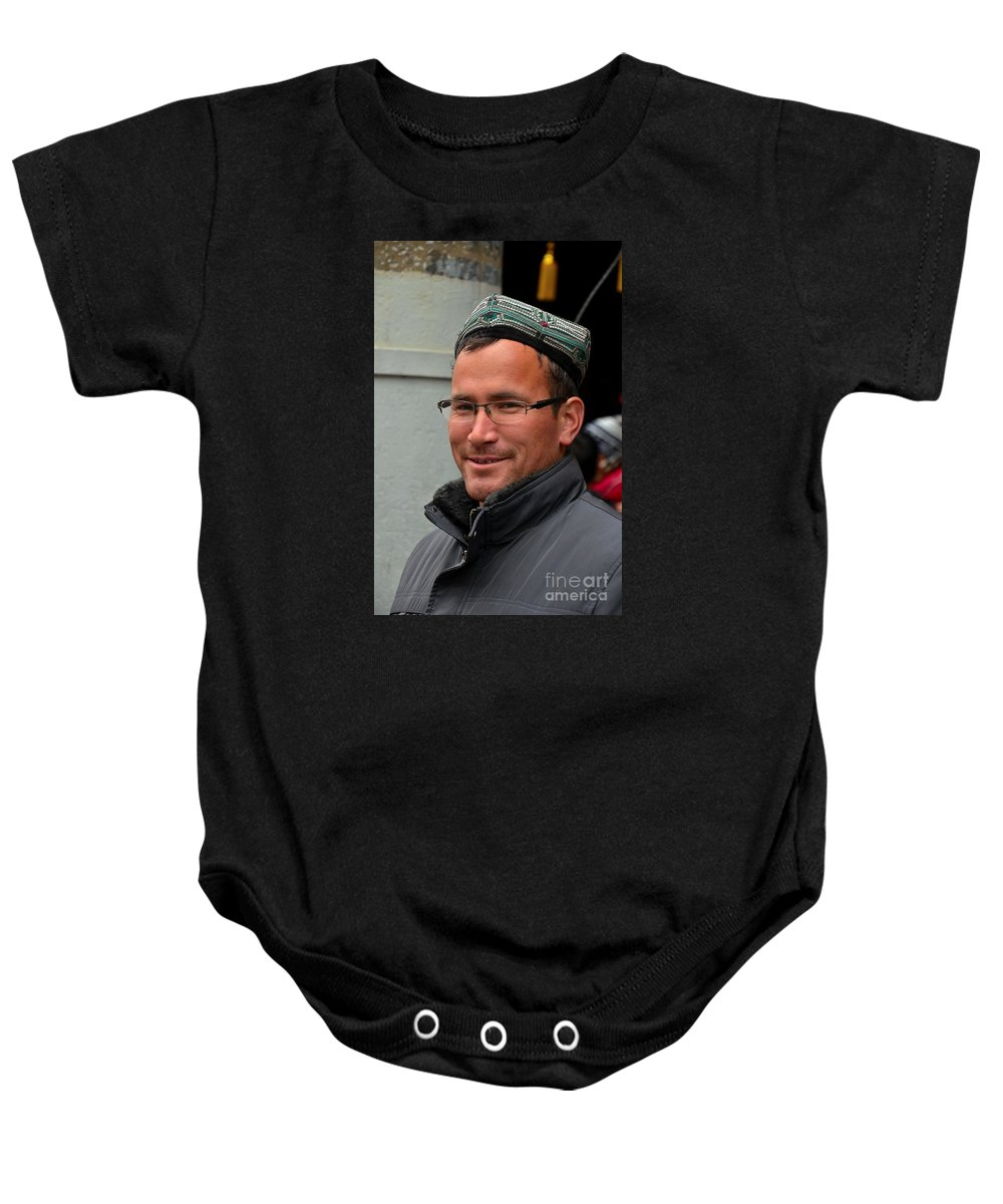 Smile Baby Onesie featuring the photograph Uighur Man In Traditional Cap Smiles by Imran Ahmed