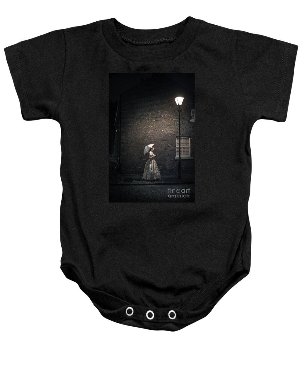 Victorian Baby Onesie featuring the photograph Victorian Woman Beneath A Street Lamp by Lee Avison