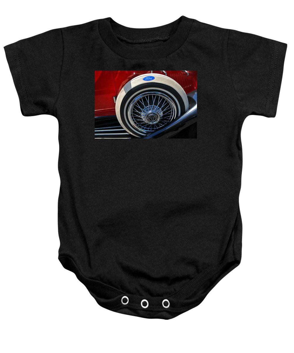 Car Baby Onesie featuring the photograph Vintage 1931 Ford Phaeton Spare Tire by Mike Martin