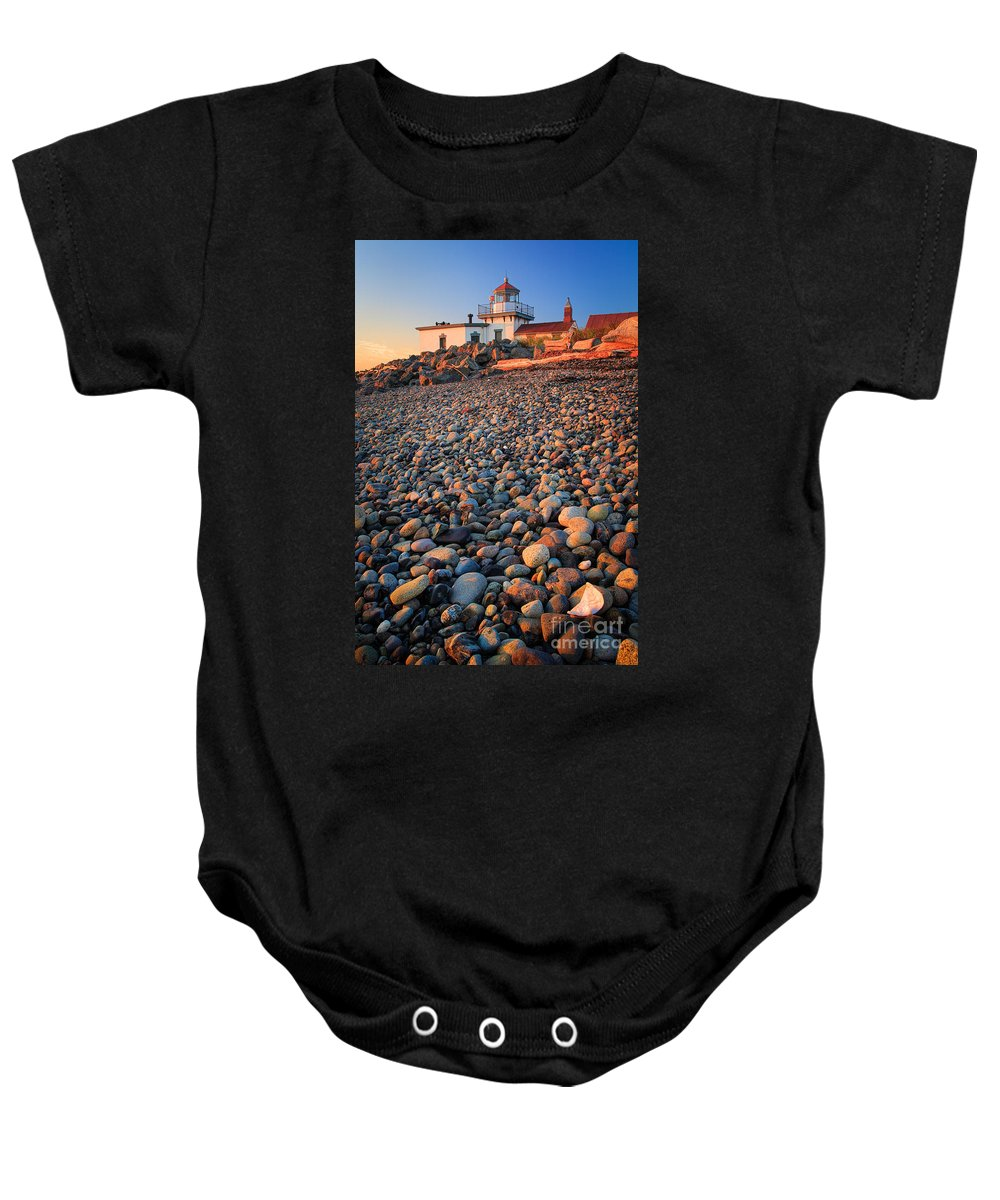 America Baby Onesie featuring the photograph West Point Lighthouse Rocks by Inge Johnsson