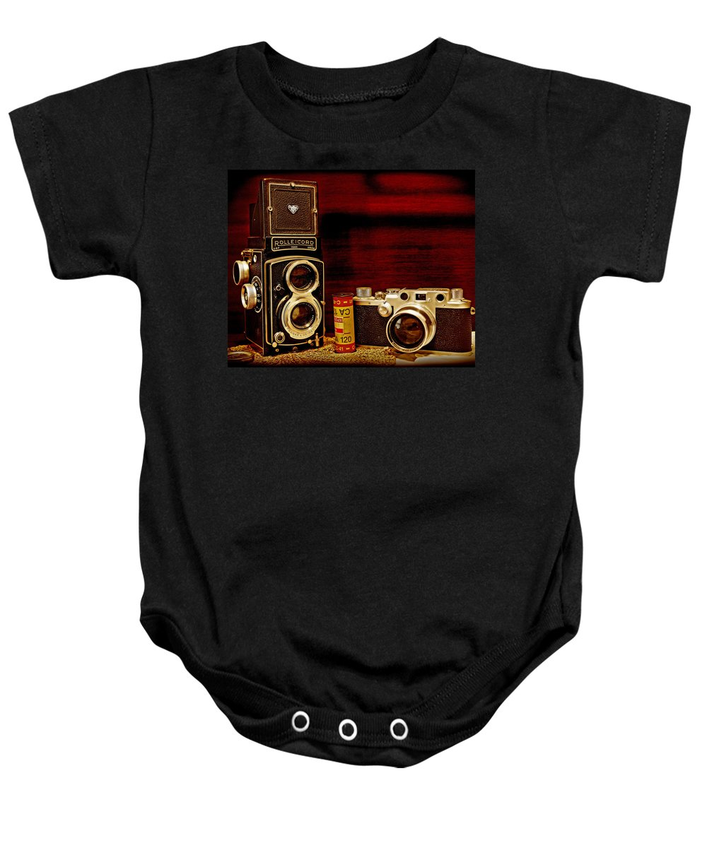 Cameras Baby Onesie featuring the photograph When Film Was King by John Anderson
